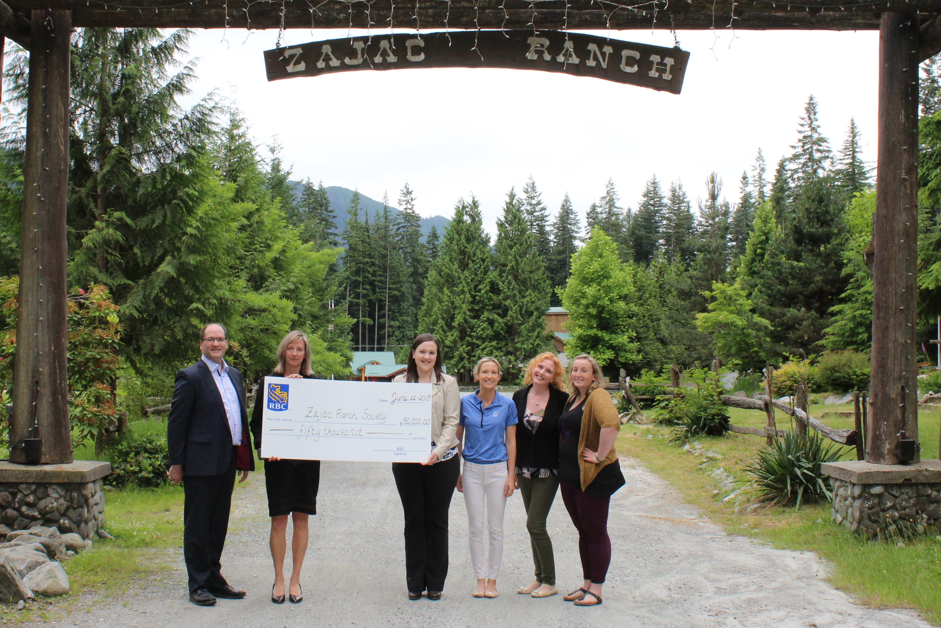 RBC and Zajac Ranch representatives with giant cheque